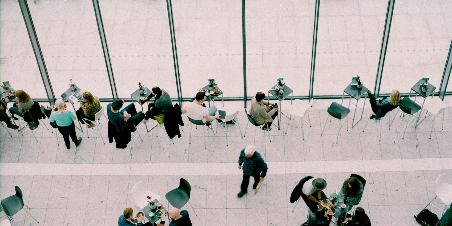 Groups of people drinking coffee at tables