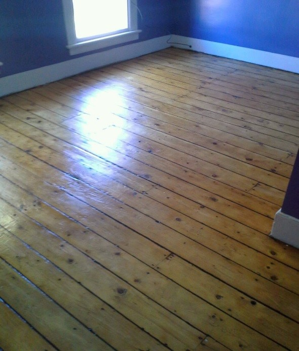 Master Bedroom fir wood floors restored - author provided image