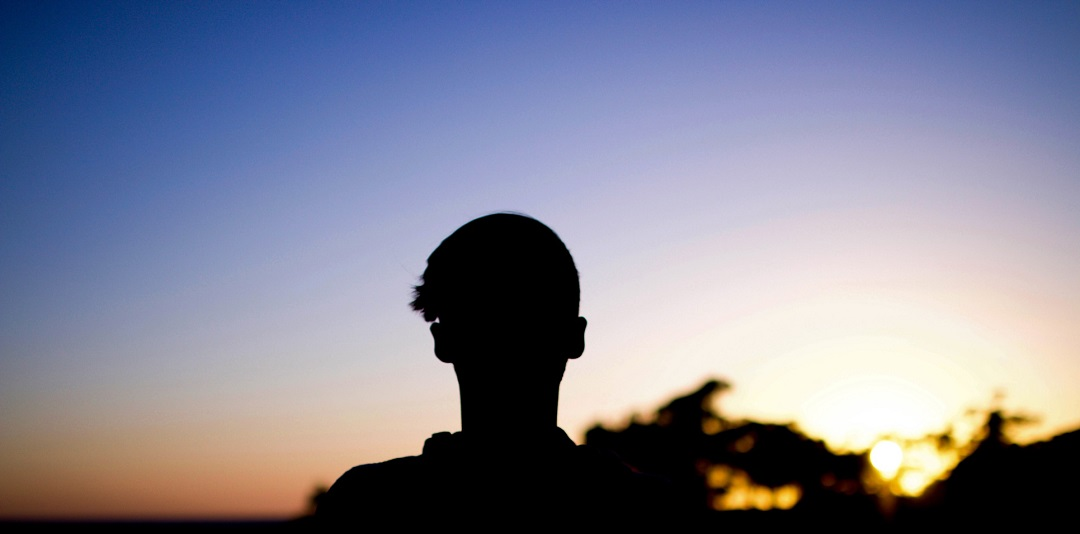 silhouette of person in sunrise