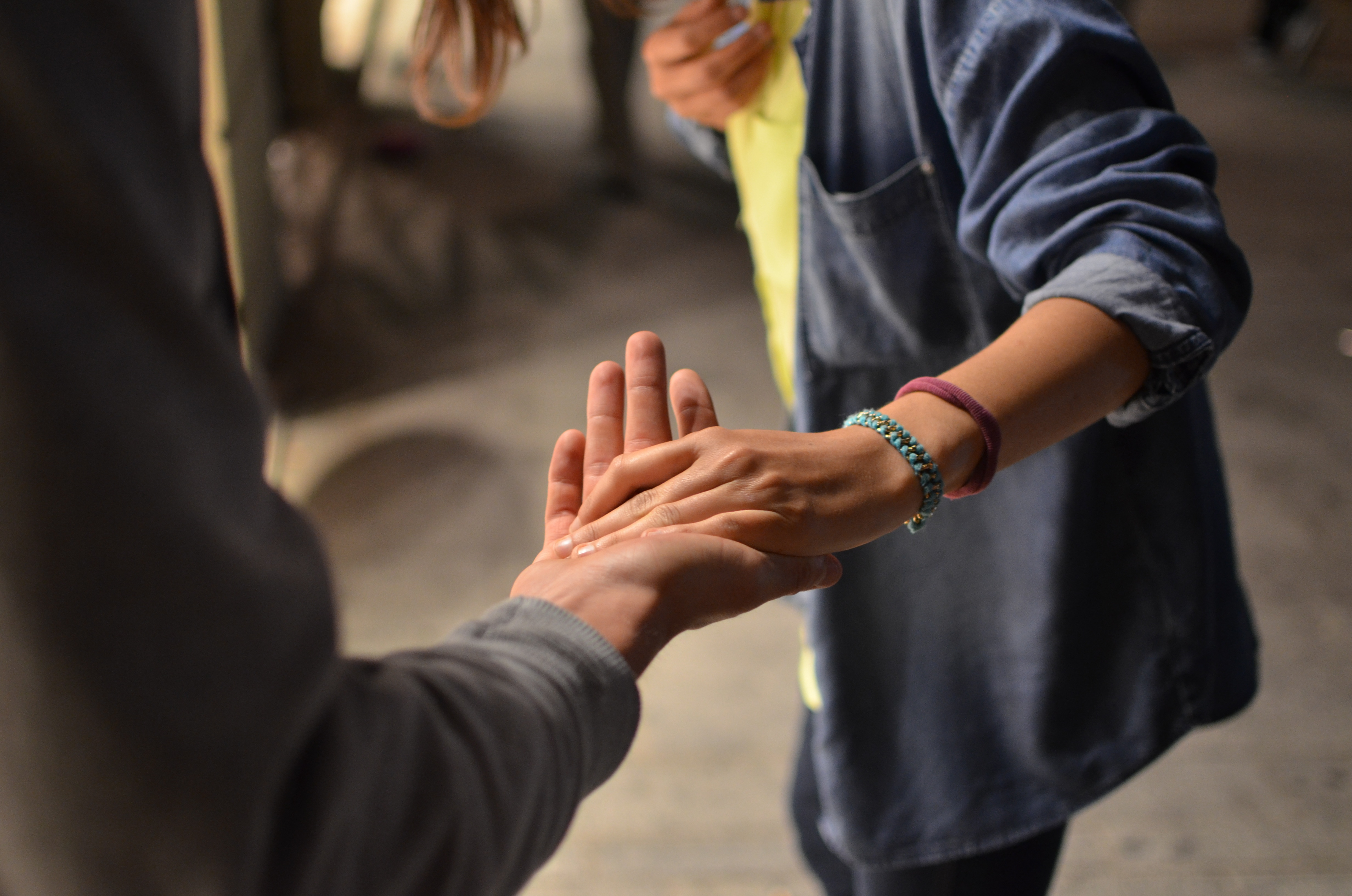 Person holding another person's hand