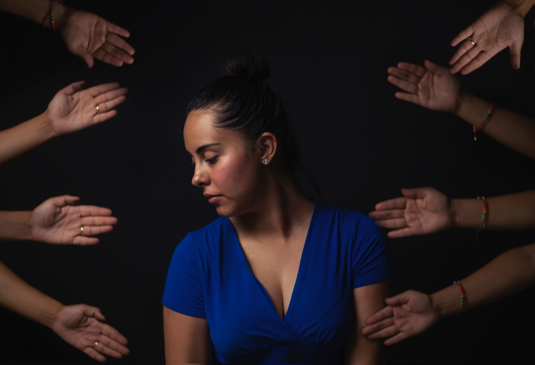 Hands reaching out to help a young woman