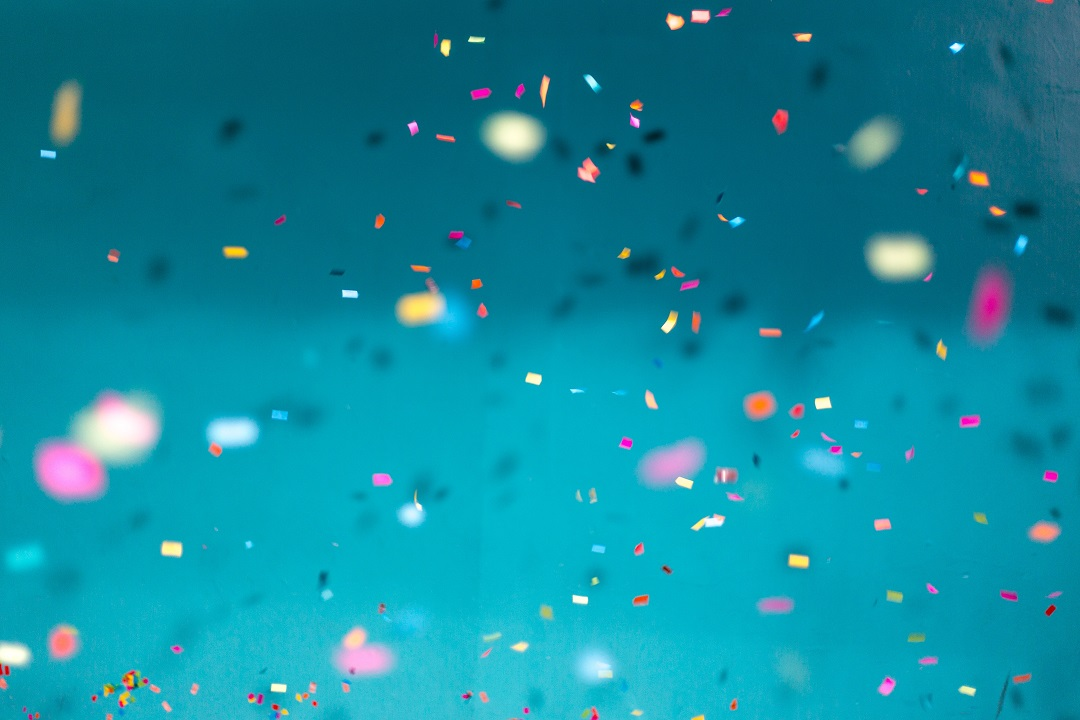 Multicolored confetti in a blue room