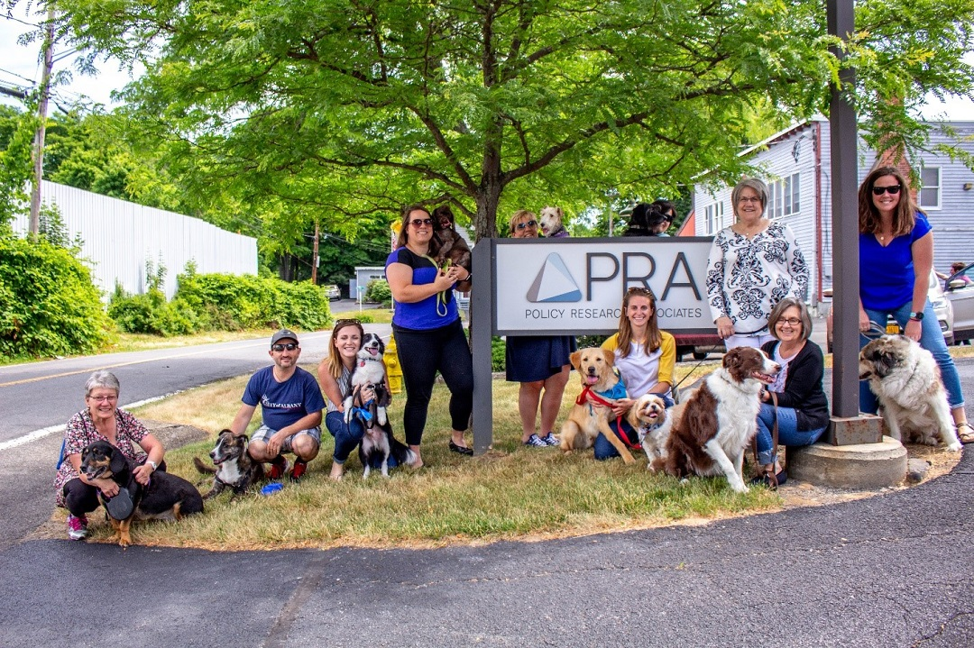 Take Your Dog to Work Day at PRA -- 10 staff members with their dogs