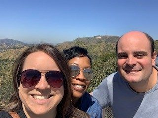Abby, Daz, and Dan taking a selfie on a road trip in California