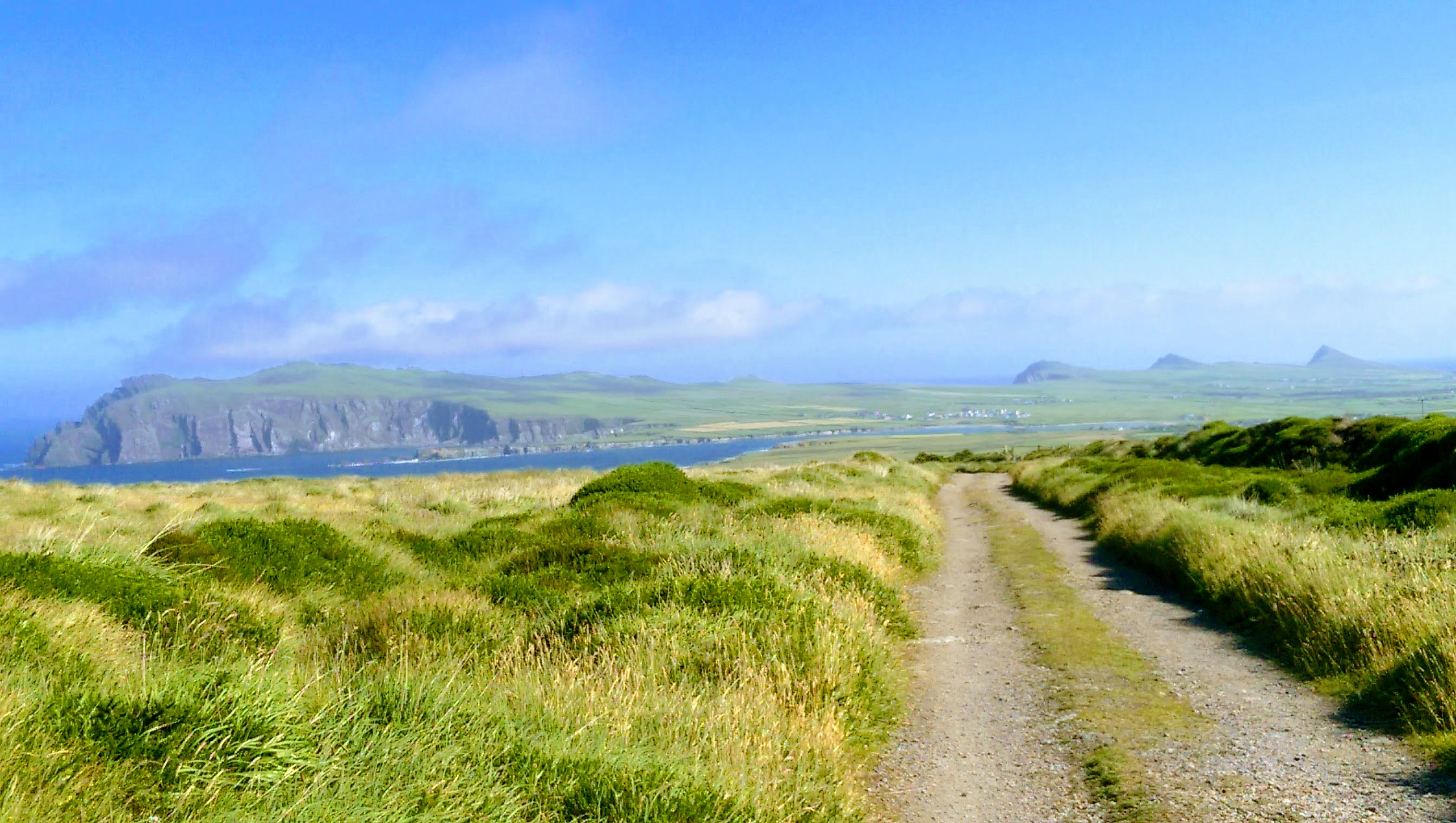 View of fields, bluffs, and the sea on an Irish Walking Trail