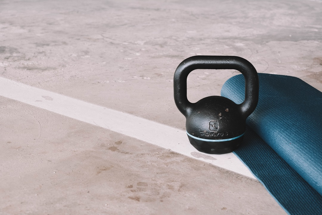 Kettlebell and yoga map on the ground