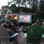Poolside movie night with social distanced lawn chairs
