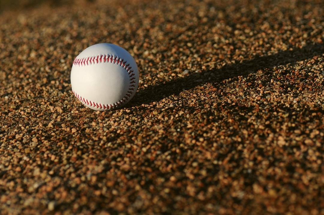 Baseball on a dirt baseball field